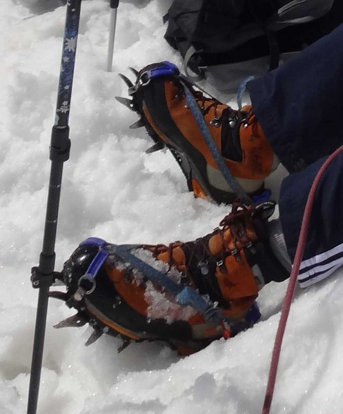 A closeup of crampons -- nasty looking fierce beasts.