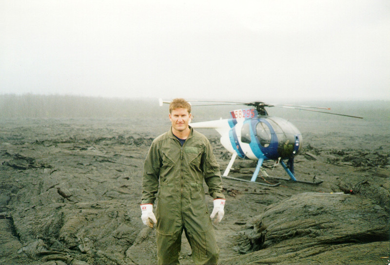 National Science Foundation (NSF) Earth Sciences Instrumentation and Facilities program manager Russ Kelz helps install high-precision GPS sites on Kilauea volcano, Hawaii, circa 1999. Helicopter piloted by David Okida. (Photo provided by Russ Kelz)