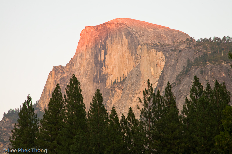 Last light falling on Half Dome at dusk. Yosemite valley, Yosemite National Park, California, USA.