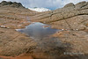 Snow melt puddle with reflections, White Pocket, Vermillion Cliffs National Monument, Arizona<br /> <br /> The reflection almost make it look like there is a rock arch that you can see through.