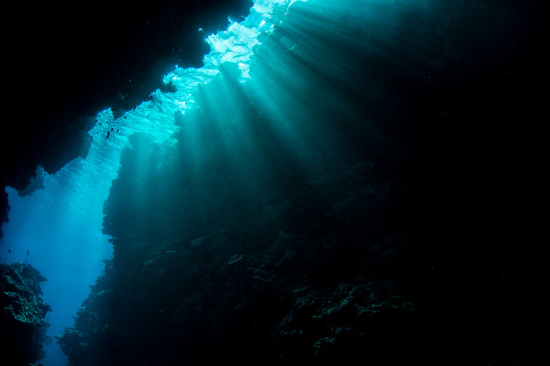 Light rays hitting a narrow cut in the reef