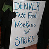 Striking fast food worker, outside a Denver area McDonalds was among over 50 people demonstrating for higher wages.