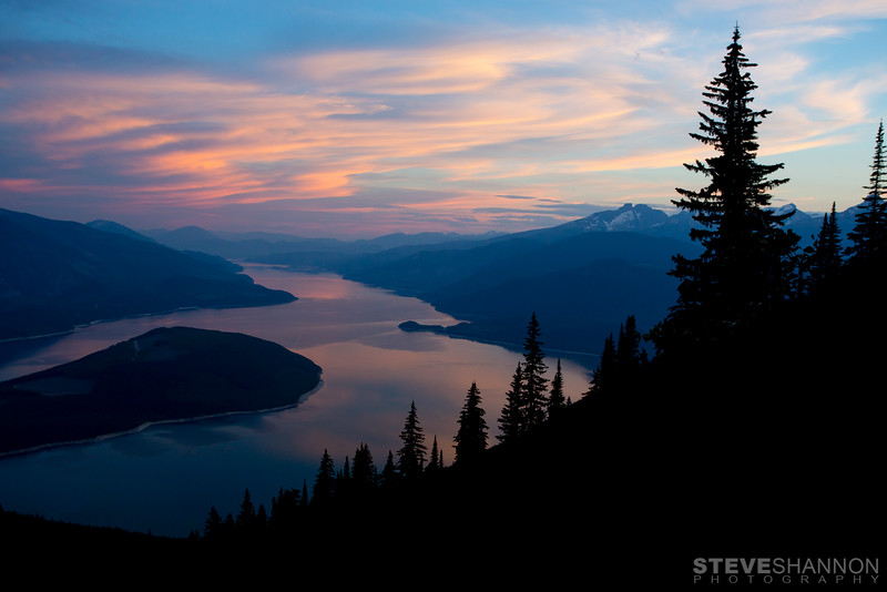 Sunset over Arrow Lake from Sproat Mountain south of Revelstoke, British Columbia.