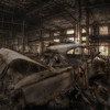 abandoned car in derelict factory
