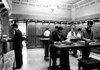 Students using Doheny Library card catalog, USC,  [s.d.]