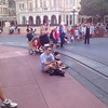 Nate and Daddy watching a show on Main Street USA