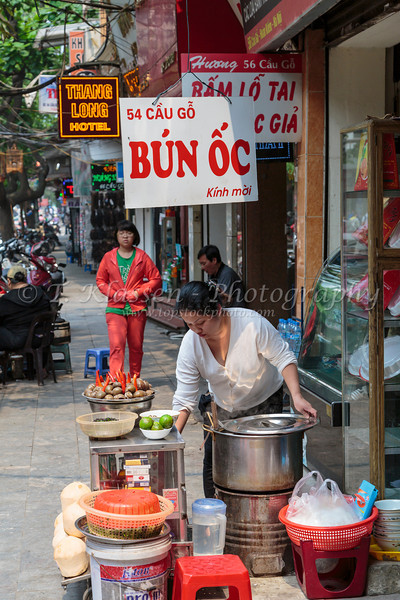 An informal outdoor street restaurant in Hanoi, Vietnam, Asia.