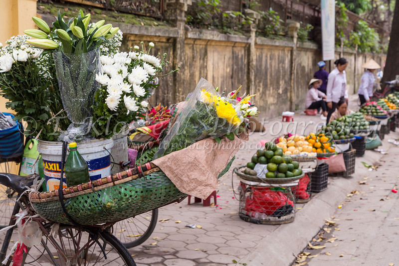 A street vendor selling flowers in Hanoi, Vietnam, Asia.