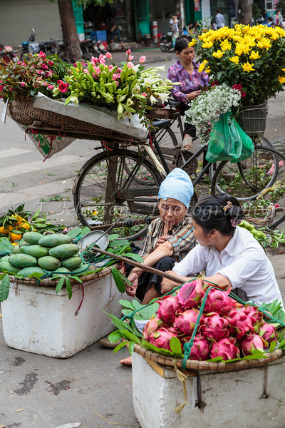 A street vendor selling fresh produce in Hanoi, Vietnam, Asia.