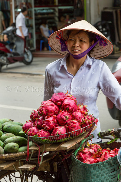A street vendor selling fresh dragon fruit in Hanoi, Vietnam, Asia.