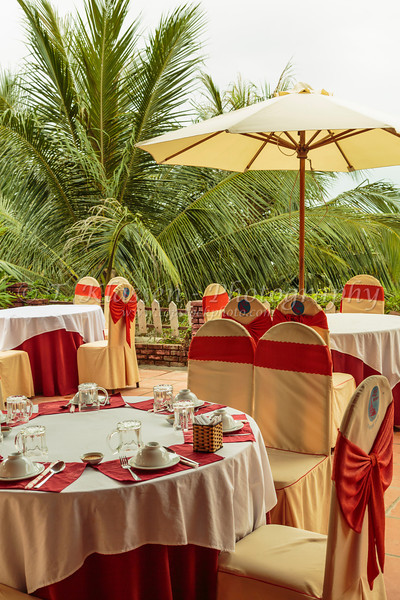 Table setting at an outdoor restaurant at the Thanh Tam Seaside Resort near Hue, Vietnam, Asia.