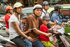 A family on a motorbike on the street in downtown Hanoi, Vietnam, Asia.