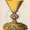 Vintage illustration of a Golden Chalice from DRESSES & DECORATIONS OF THE MIDDLE AGES by Henry Shaw, 1843. The natural age-toning, paper stains, and antique printing imperfections are preserved in this 1800s vintage stock image.