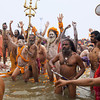 Maha Kumbh Mela. Sangam. Naga Sadhus. Worship. Ganges. Royal Bath. Sword.