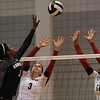 Megan Spencer (3) and Jasmine Eatmon (17) jump up to block a South Carolina spike during an SEC volleyball match against the University of South Carolina on Sunday, Nov. 10, 2013 in Athens, Ga. The Bulldogs won three games to none. (Photo by Sean Taylor)