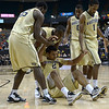 Devin Thomas helped to his feet by team after foul