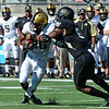 Marquel Le tackles X Moss after catch