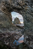 Sunset view of a sea stack through a hole in another sea stack. Taken at Rialto Beach, Olympic National Park, Washington, USA.
