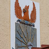 Maxwell AFB -WWII Coat of Arms: the colorful coat of arms belonged to the Southeast Air Corps Training Center (SEATC), later known as the Eastern Flying Training Command (EFTC).  This command directed flying training throughout the southeast from Maxwell Field during WWII.  This insignia was drawn up at the Training Cneter HQ at Maxwell Field.  It was adopted by Maj Gen Walter R Weaver as the device which best symbolized the organization and purpose of the training center as a whole.  Maxwell's wartime record is an impressive one.  Its training program produced over 100,000 aviation cadets, including some from Great Britain, France, China, and other allied nations.<br /> Montgomery, AL - 26 Feb 2013