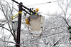 Lineman works among the icy  treetops on Hhighland Avenue during a power outage in Lansdale Wednesday,  February 5, 2014.   Photo by Geoff Patton