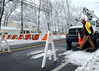 A Verizon technician works on lines down caused by the snowy weather across County Line Rd between Hatfield Township and New Britian Township which closed a section of the road on Tuesday  February 4,2014. Photo by Mark C Psoras/The Reporter