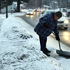 Henry Hamilton, who lives on Rt 38 in Tewksbury, finishes up shoveling his front walk and driveway after about an inch of snow fell. He said he likes to keep the walk clear for pedestrians, and it's good exercise for him. (SUN/Julia Malakie)