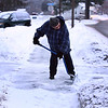 Henry Hamilton, who lives on Rt 38 in Tewksbury, shovels his front walk and driveway after about an inch of snow fell. He said he likes to keep the walk clear for pedestrians, and it's good exercise for him. (SUN/Julia Malakie)