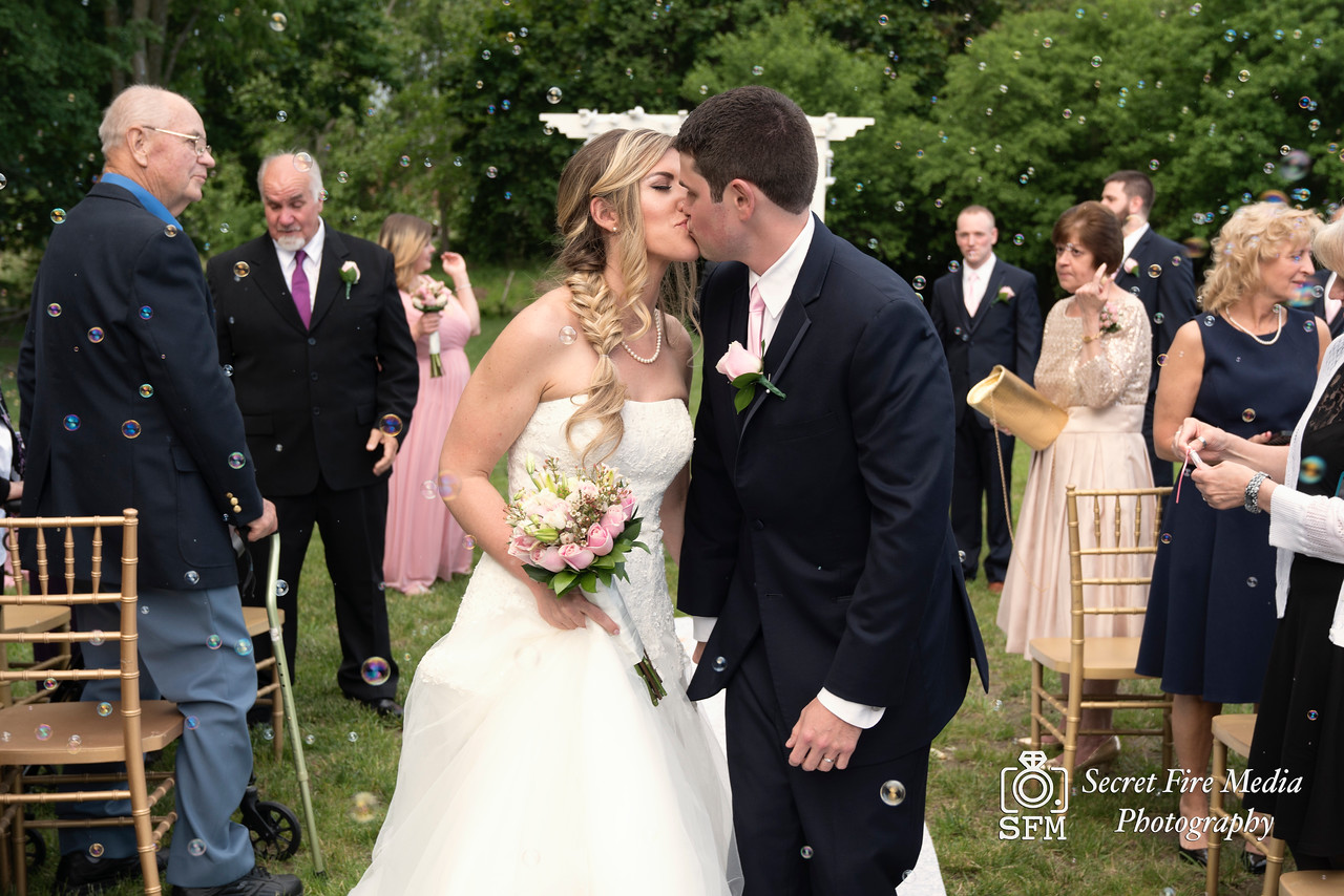 Bride and groom kiss surrounded by bubbles at their Hudson Valley Wedding At Palacios in Goshen New York