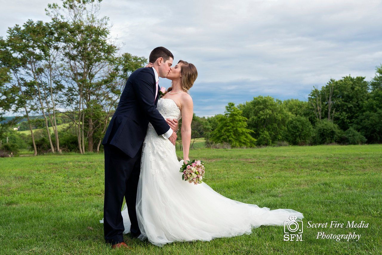 Bride and Groom dip and kiss for a photo at their Hudson Valley Wedding At Palacios in Goshen New York