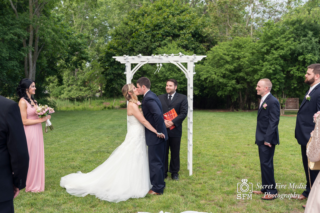 Bride and grooms first kiss at their Hudson Valley Wedding At Palacios in Goshen New York