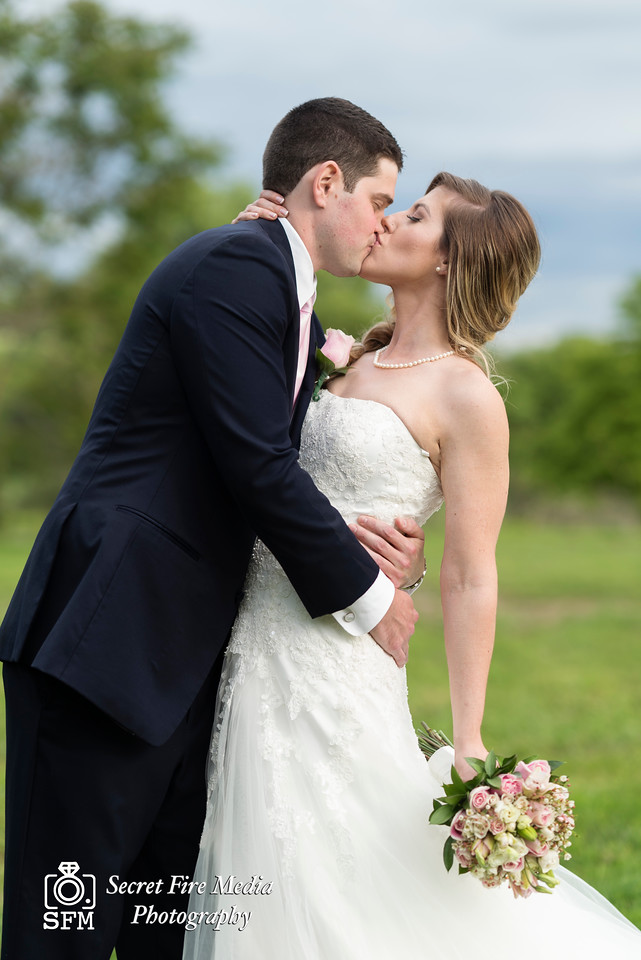 Bride and Groom kiss for a photo at their Hudson Valley Wedding At Palacios in Goshen New York