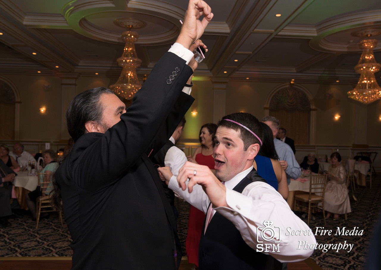 Groom and guest dancing at a Hudson Valley Wedding At Palacios in Goshen New York