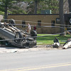 Record-Eagle/Brian McGillivary<br /> A rollover on Munson Avenue Friday took out a utility pole that cut power to around 150 homes and businesses served by Traverse City Light & Power. Micheal Cleggett, 22, of Kalkaska, was traveling west when his sport utility vehicle veered off the road and crashed around 11:20 a.m., police said. Power was restored to most customers within an hour, but about a half-dozen businesses waited longer as work crews replaced the pole and transfer wires, utility officials said. Cleggett was not hurt but was ticketed by police.