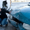 Record-Eagle/Douglas Tesner<br /> Julia Krueger, 18, checks the damage to her car after being hit from behind while making a right turn off Eighth Street and struck the Eastfield Laundry building near Garfield.  Krueger said one one was injured.  Neither police  nor the second driver could be reached for comment on the accident.