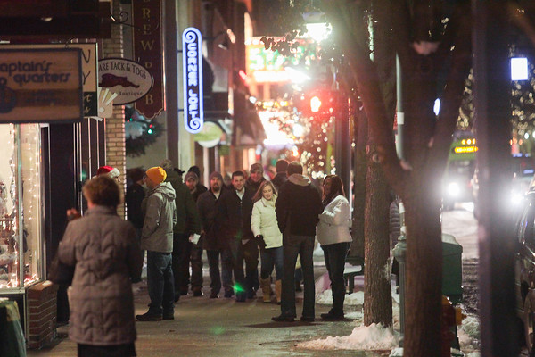 Record-Eagle/Keith King Shoppers travel along Front Street Thursday during Men's Night in downtown Traverse City.