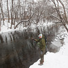 Record-Eagle/Keith King Andre Martin, of Traverse City, uses a center-pin reel to float fish Thursday for steelhead and brown trout on the Boardman River. Martin practices catch and release and caught a brown trout earlier in the day.