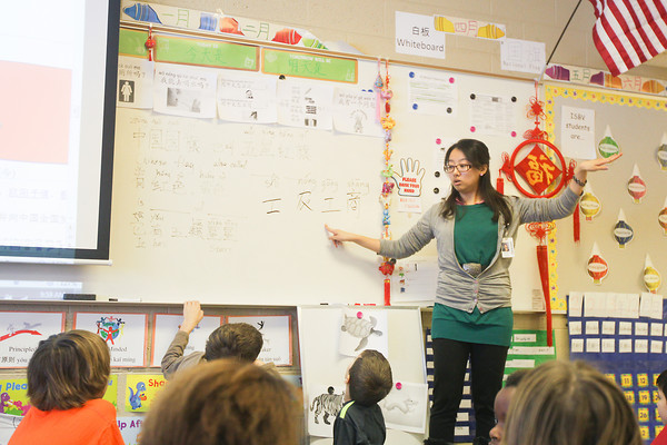 Record-Eagle/Keith King Yiling Liu, from China, teaches Wednesday in her class at Traverse City Area Public Schools (TCAPS) International School at Bertha Vos in Williamsburg.