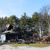 Record-Eagle/Keith King What remains of the house where George and Sally Shetler, owners of Shetler Family Dairy, lived, stands at Amazing Grace Farm in Kalkaska County's Excelsior Township Thursday, December 13, 2012 after a fire started there Wednesday.
