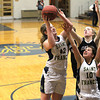 Record-Eagle/Jan-Michael Stump<br /> Traverse City St. Francis' Bridget Bussell (42) grabs a rebound over Lydia Arthur (10) and Elk Rapids' Rachel Hintz (34) in the second half of Monday's game.