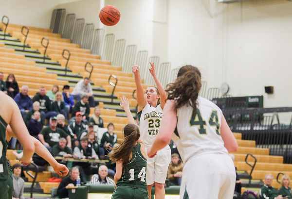 Record-Eagle/Keith King Traverse City West's Kimmy Bilinski (23) shoots the ball against Alpena Friday during the Class A district championship game at Traverse City West High School.