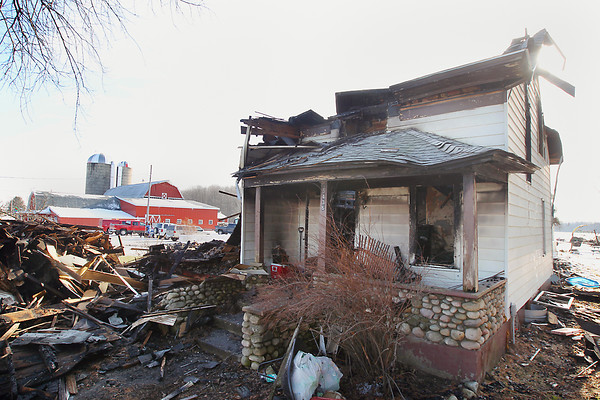 Record-Eagle/Keith King<br /> <br /> What remains of the house where George and Sally Shetler, owners of Shetler Family Dairy, lived, stands at Amazing Grace Farm in Kalkaska County's Excelsior Township Thursday, December 13, 2012 after a fire started there Wednesday.
