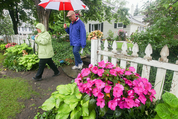 Record-Eagle/Keith King<br /> Kay and Jim Goodall, of Kewadin, walk at the Hresko Gardens during the Elk Rapids Garden Club Presenting Artful Gardens garden walk.