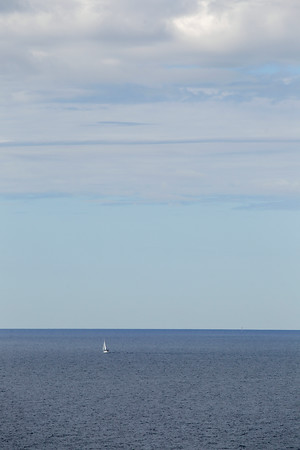 Record-Eagle/Keith King<br /> A sailboat, viewed from Elberta, travels Wednesday on Lake Michigan.