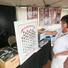 Record-Eagle/Keith King<br /> Kathy Morio, of Lake Leelanau, looks at a National Cherry Queens poster displayed for sale by Bulls-i, in cooperation with the National Cherry Festival, at the Open Space.