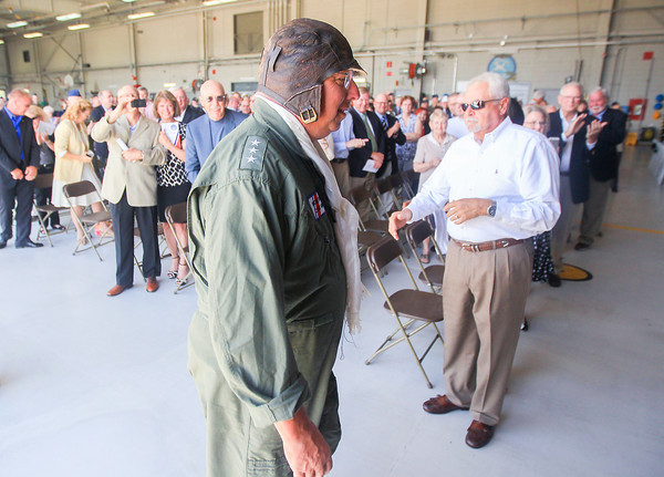 Record-Eagle/Keith King<br /> Vice Admiral John Currier, 23rd United States Coast Guard Ancient Albatross, receives applause as he walks past attendees after landing in a Coast Guard helicopter for the Ancient Albatross Change of Watch at the United States Coast Guard Air Station Traverse City.