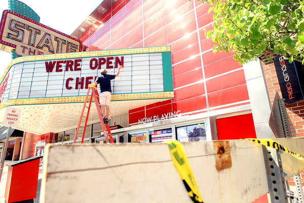 Record-Eagle/Keith King<br /> Steve Weldon, State Theatre volunteer, places letters on the marquee announcing the opening of the State Theatre after it was closed following the collapse of a structural column at Red Ginger. Horizon Books was also reopened.