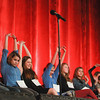 Record-Eagle/Keith King<br /> Participants stretch after a suggestion to do so before the start of a round Sunday during the 2014 Grand Traverse Regional Spelling Bee at the State Theatre in Traverse City.