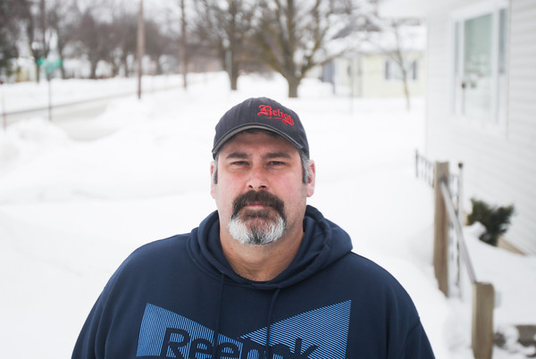 Record-Eagle/Keith King<br /> John Cunningham, of Traverse City, stands near his home.