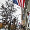 Record-Eagle/Keith King An American flag flies as Jack and Karen Segal, of Traverse City, walk in windy conditions Monday, November 18, 2013 along Union Street in Traverse City.