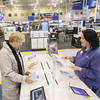 Record-Eagle/Keith King Ann Knapp, left, of Alden, is assisted Tuesday, November 26, 2013 by Anne Cole, employee, at Best Buy in Traverse City.